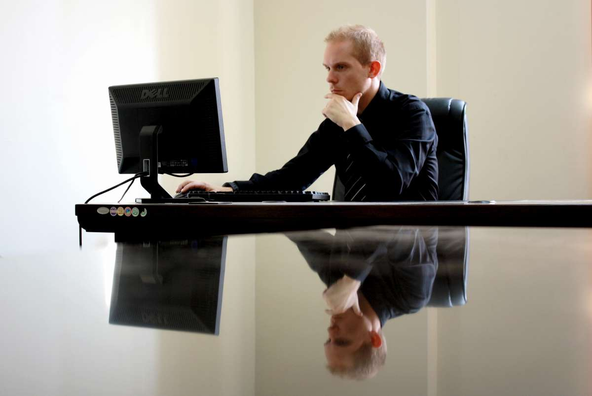 Canva Man Sitting Facing Pc Inside Room